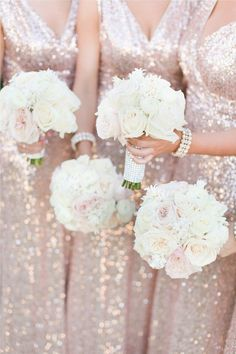 White Rose Wedding Bouquets with Sparkly Bridesmaid Dresses: There is no more glamorous combination than white roses and rose gold dresses for a winter wedding. With this much party power, we're thinking New Year's Eve nuptials is the only way to go. | 10 Ideas for White Rose Wedding Flowers for Your Ceremony and Reception