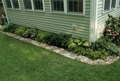 Rock border--Put down a weed barrier (cardboard, newspaper or weed blocking material) under rocks. Idyll As the Aloe Spirals - Perennials Forum - GardenWeb Landscaping Around House, Landscaping With Rocks, Front Yard Landscaping, Landscaping Ideas, Mulch Landscaping, Garden Yard Ideas, Lawn And Garden, Home And Garden, Backyard Ideas