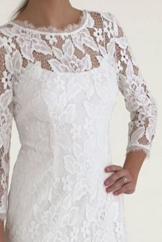 Stand out on your special day in this simple yet unforgettable illusion sleeve V-back lace dress!  Short all over lace dress features illusion 3/4 sleeves and a sultry V-back for