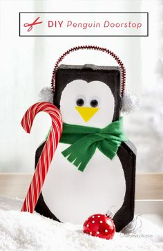 """Penguin Doorstop. I might make mine a little sign to hold/wear that says, """"This house is protected by guard penguins."""""""
