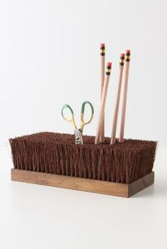 Great idea!  Use top of push broom as pencil caddy on potting table!