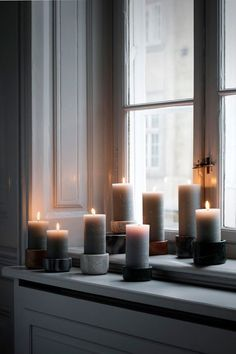 On a grey and rainy day like this we light up rustic candles in marble candlesticks from our collection by brostecph Fall Collection, Salons Cosy, Rustic Candles, Pillar Candles, Christmas Feeling, Broste Copenhagen, Hygge Home, Candle Lanterns, Window Sill