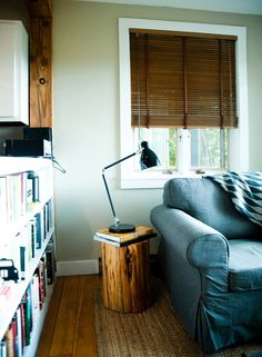 Wood blinds; book shelf; couch; lamp | Img source: NYTimes.com. ( My first sponsored post and I think I rocked it! I wrote it exactly the way I would have written it anyway and was considering doing the post in the first place. No guest post.)