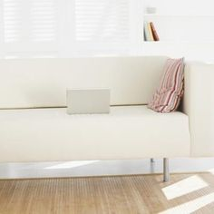 Contemporary couches like this one are easily covered with fabric and staples.