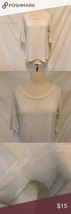 Ultra Flirt White Dolman Sleeve Basic Top Size S Ultra Flirt. Size small. White dolman Sleeve Basic Top. 3/4 Quarter Sleeve Length. See through. Lightweight knit material. Heathered look to it. Excellent used condition with no signs of wear. Bust: 22.5 inches. Length: 28 inches. ALL MEASUREMENTS ARE TAKEN WITH ITEM LAYING FLAT. 60% viscose, 40% polyester. ||1062|| Ultra Flirt Tops