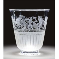 A large Orrefors engraved glass vase , designed 1941 by Simon Gate and engraved by Karl Rossler, the body with a wide frieze of revelling naked figures above a band of frosted fluted decorated with simplified flowers engraved mark, `Orrefors, Gate, 2589, C5' and engraver's initials