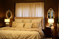 Like the gathered curtain to keep the light, but minimize the effect of placing a bed in front of a window.  Good way to utilize all walls.