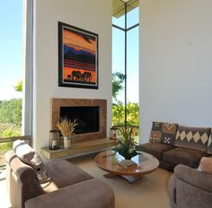 Anderson Brule - Architect - San Jose - Modern - Contemporary - Print - Gallery - Display - Art - Frame - Fireplace - Sleek - Neutrals - Glass Walls - Large Windows - Round Coffee Table - Upholstered Seats - Living Room