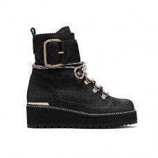 Fashion Market Editor Tiffany Reid's Favorite Waterproof Boots: Stuart Weitzman Attackit Bootie | coveteur.com