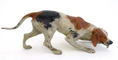 """A cold painted bronze figure of a hound marked ' Geshultz ' under, standing 3 1/8"""" high x 9"""" long."""