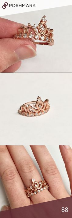 Rose Gold Crown Ring Sz 8 Fit for a queen. This intricate rose gold colored ring is accented with sparkling clear rhinestones. Brand new and never worn. Size 8. Not intended for children under 12. Jewelry Rings