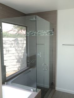 Frameless Shower System With Polished Chrome Hardware. We stock an extensive line of frameless shower door units, door hardware and components with a variety of different types of temped glass. Allow us to assist you with your complete frameless shower doors units and design.