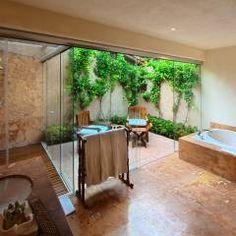 Casa Sol : Baños de estilo Tropical por José Vigil Arquitectos