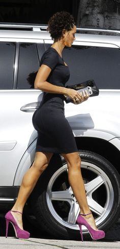 nicole murphy makes that simple black dress SIIIIING... love the pop of color with the shoes... but with that body, who's looking at the shoes :-)
