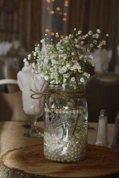 Baby breath centerpiece in Mason jar - rustic wedding. Pearls on bottom of jar
