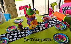 Table at a Alice in Wonderland Party.  See more party ideas at CatchMyParty.com.  #aliceinwonderland #partyideas