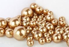 8 Ounce Bag Approx 68 Pearls Wholesale Elegant Vase Fillers or Table Scatter Golden Pearl Beads - Unique Decorative Beads for Weddings, Centerpieces and More by Holiday Accents, http://www.amazon.com/dp/B00771PYJ2/ref=cm_sw_r_pi_dp_TAF6qb09MVBXW