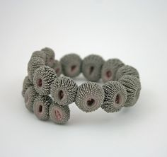 Bracelet - Urchin silk and silicone|Tzuri Gueta  WTF THATS INCREDIBLE they're like mini cactuses!