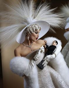 """Mae West Played by Model Laetitia Casta by Photographer Jean-Paul Goude - Harper's BAZAAR   """"The best way to hold a man is in your arms.""""  Hat, by special order, Benoît Missolin, Couture. #passion4hats"""