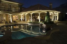Shop VOLT lighting to make this stunning patio and pool look your own! Patio Lighting, Landscape Lighting, Cool Landscapes, Underwater, Bulb, Backyard, Mansions, House Styles, Shop