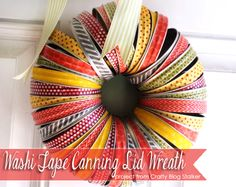 Make a fall wreath with washi tape and canning lids. Check out the tutorial!