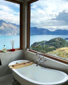 This Queenstown, New Zealand home features a bathtub with an absolutely stunning alpine view overlooking Lake Wakatipu. Bathroom Interior Design, Home Interior, Modern Bathroom, Small Bathroom, Bathroom Ideas, Bathroom Organization, Minimal Bathroom, Funny Bathroom, Bathroom Inspiration