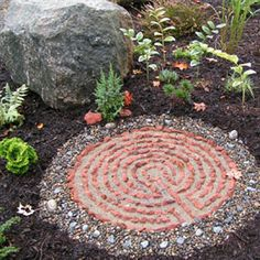 small garden labyrinth made of colored rocks.