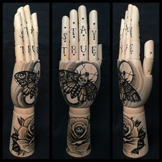 Wooden hand mannequin with original drawing of a death's head moth and rose with all seeing eye 'tattoo style'