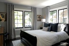 A typically glamorous Jeff Lewis design - those black framed windows raise the game in a whole new way. (Click through to see the before and after images. Bedding Master Bedroom, Gray Bedroom, Master Bedroom Design, Home Decor Bedroom, Bedroom Ideas, Grey Green Bedrooms, Gray Rooms, Grey Walls, Jeff Lewis Design