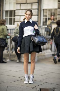 More Than 170 Street-Chic Snaps to Fuel Your Winter Style : Pep up a Fall skirt and sweater combo with a pair of sporty kicks. These high-tops are just as practical as Fall ankle boots but lend a little on-trend, athletic appeal.  Source: Adam Katz Sinding