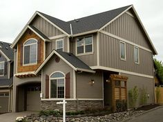 I think this house is pretty with the exterior colors and textures.