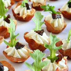 Elegant Appetizer - Prosciutto Cups w Goat Cheese Whip, Dried Mission Fig topped with a Sprig of Arugula.