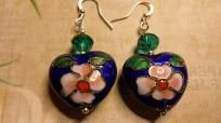Swarovski Crystal & Cloisonné Puffed Heart Earrings  Beautiful teal swarovski crystalsaccent a cool & uniqueblue Cloisonné puffed heart. Hangs from a silver french hook ear wire. Super lightweight!! Measures approx. 1 3/4 inches in length. Hand m...