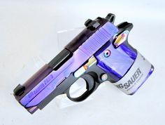 """Sig Sauer P238 Purple Pearl .380 ACP. 238-380-PSP. Sig Sauer's P238 is a compact semi-automatic CCW pistol inspired by the 1911, with the thumb safety, magazine release and slide stop lever in familiar places. This Lipsey's Exclusive model features a black alloy frame, Purple PVD finished slide, Purple Pearlite Grips, and Rainbow Ti accents. SIGLITE night sights & ambidextrous controls. 6+1 capacity of .380 ACP. 2.7"""" barrel. 15.2 oz. [New in Box] $629.99"""