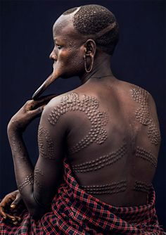 "Africa | Mursi woman, Change Beye.  Gore Ramacho, South Omo Valley, Ethiopia | ©Pit Buehler from a series called ""African Vogue"" October 2013."