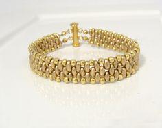 Gold beaded narrow cuff bracelet by lizardpoint