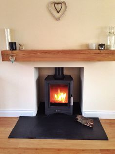 Wood burning stove, oak beam, slate hearth, Scottish home Scandinavian (log burning fires wood stoves) Wood Burner Fireplace, Oak Mantle, Wooden Mantle, Fireplace Hearth, New Living Room, Home And Living, Living Room Decor, Contemporary Wood Burning Stoves, Log Burning Stoves