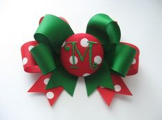 "Personalized Monogram Initial Red and Green Holiday Themed Bow   Stylish and trendy holiday themed monogram bow is perfect to wear to one side or addy to pony tail, hat or headbands. Available on partially lined double prong alligator clip. Approximately 3.75"" wide. No slip grip can be added on..."