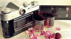 http://wallpaperscraft.com/image/camera_film_books_flowers_dry_petals_54214_1366x768.jpg