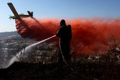 July 15, 2012. A firefighting plane drops retardant on a forest fire burning near Ein Hemed, west of Jerusalem, Israel.    Read more: http://lightbox.time.com/2012/07/20/pictures-of-the-week-july-13-july-20/#ixzz21m3lW0YC