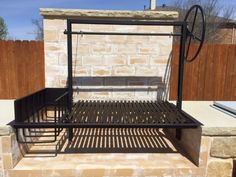 Argentine Grill Kit with Side Brasero and Emberguard installation closeup