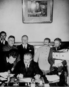 National Archives, Soviet Foreign Commissar Vyacheslav Molotov signs the German-Soviet nonaggression pact