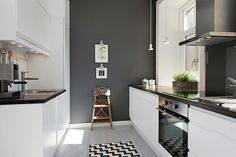 Grey feature wall in a white kitchen