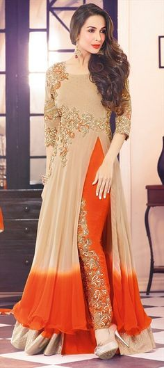 Deepen your unfathomable beauty as Malaika Arora Khan does clad in this beige and orange georgette pant style suit. The ethnic lace, resham and stones work in the dress adds a sign of splendor statement with a look. Party Wear Indian Dresses, Indian Gowns Dresses, Pakistani Bridal Dresses, Pakistani Outfits, Indian Outfits, Kurti Designs Party Wear, Desi Clothes, Indian Attire, Traditional Dresses