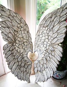 Something quite interesting...Large Angel Wings hand crafted and sculpted by solamar7 via Etsy.