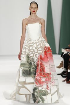 We're loving the broken large floral print on this @HouseofHerrera #NYFW #MBFW #SS15 structured A-line maxi dress.
