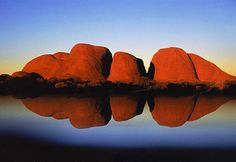 Kata Tjuta rock formations reflected in lake at dusk, Uluru-Kata Tjuta National Park, Australia (© Kul Bhatia/Corbis The large formations dwarf everything around them in this national park. Also a spiritual site for the Aboriginal population. Outback Australia, South Australia, Australia Travel, Places To Travel, Places To Go, Ayers Rock, Road Trip, Places Around The World, Natural Wonders
