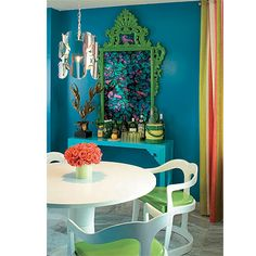 Teal wall in colorful room.