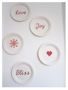 Cross stitch on paper plates. Delightful!