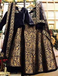 Give yourself an unique look by wearing this exquisite black taffeta silk lehenga choli. This spectacular attire is highlighted interestingly fancy embroidery work that gives a divine look to the outfit. Paired with matching blouse and dupatta Lehenga Designs, New Lehenga Design, Party Wear Indian Dresses, Party Wear Lehenga, Indian Outfits, Lehenga Blouse, Silk Lehenga, Cotton Lehenga, Lehnga Dress